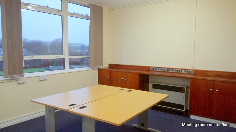 a meeting room containing a table with views over the recreation ground