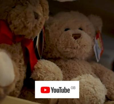 an image of teddy bears with a YouTube logo. The image is a link to a video
